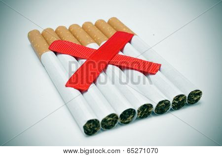 a pile of cigarettes and two crossed red slashes, depicting the concept of no smoking
