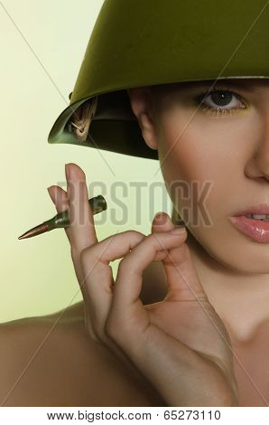 Woman With A Cartridge In Helmet