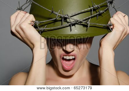 Woman In Army Helmet With Barbed Wire