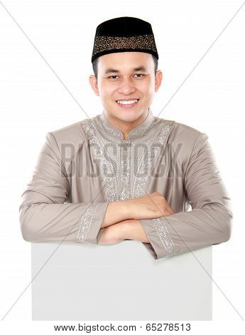 Smiling Asian Muslim Man Holding Blank Board