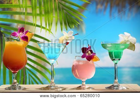 Refreshing cocktail on beach table.