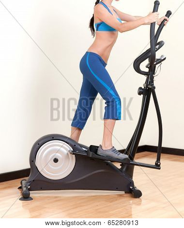 woman training on exercise bicycle air stepper