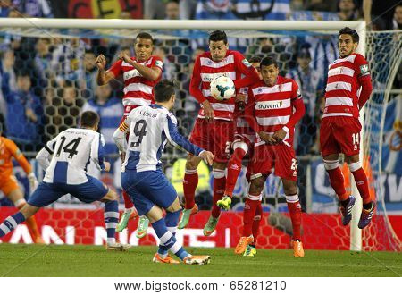 BARCELONA-APRL, 27: UD Almeria players on the wall of the free kick launched by Sergio Graica of RCD Espanyol during a Spanish League match at the Estadi Cornella on April 27, 2014 in Barcelona, Spain