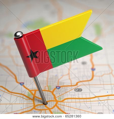 Guinea-Bissau Small Flag on a Map Background.