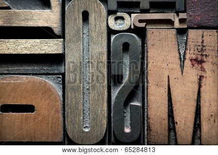 Composition with vintage wooden typescript letters