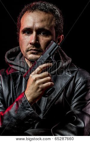 Private detective with leather jacket and gun, handgun