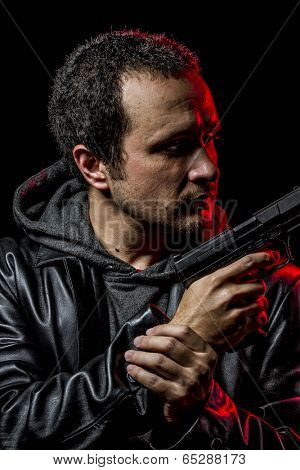 Private detective with leather jacket and gun, security