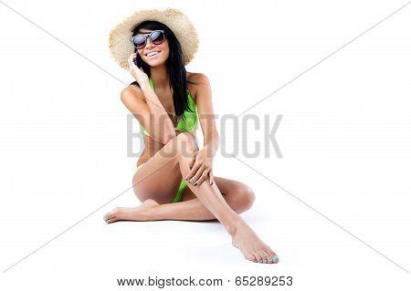 Happy Young Girl With Green Bikini Talking On Mobil Phone