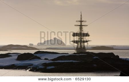 Sailing Ship Among The Icebergs