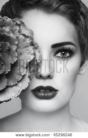 Close-up black and white portrait of young beautiful woman