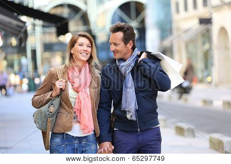 Middle-aged couple doing shopping on week-end