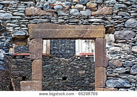 The Wall Of Ruins Of An Old House