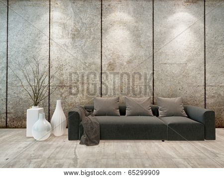 Modern minimalist sitting room interior with down lights on a grey wall above an upholstered grey sofa with ornamental vases alongside, high volume room