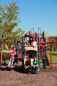 stock photo of swingset  - diverse group of multi - JPG