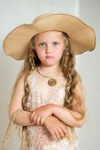 pic of little girls photo-models  - The photo shows a little girl she tries to imitate adults and look fashionable and stylish - JPG