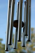 image of chimes  - A large wind chime blowing and making music in the air - JPG