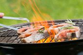 pic of salmon steak  - Delicious grilled salmon steaks on fire - JPG