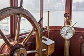 stock photo of ship steering wheel  - vintage ship bridge with steering wheel and engine controls  - JPG