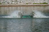 foto of aeration  - Water treatment by aerator in the pond - JPG