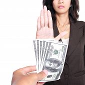 stock photo of corrupt  - conceptual image of hand give money for corruption but another refused to take the money - JPG