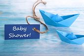 stock photo of beside  - Label with Baby Shower and Boats beside
