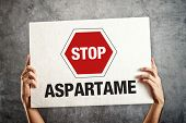 image of substitutes  - Hands holding banner with STOP ASPARTAME message - JPG