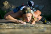 foto of climbing wall  - Vertical image of woman doing exercise on the mountain - JPG