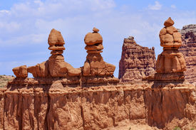 stock photo of hoodoo  - Three Sisters Hoodoos Goblin Valley State Park Rock Canyon San Rafael Desert Utah USA Southwest - JPG