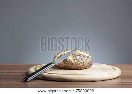 Poppy Seed Roll With Knife On Plate