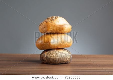 Stack Of Bread Rolls On Table
