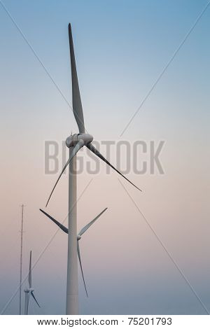 Wind Power Generation Turbine At Dusk