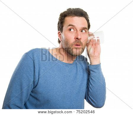 Man Listening Through A Glass (on Fictitious Wall)