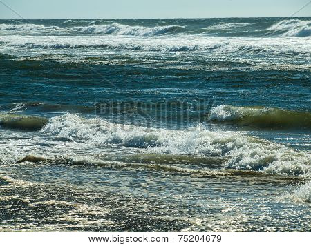 Waves Rolling On The Beach On A Sunny Day