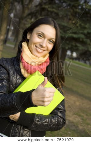 Female in the park with a folder