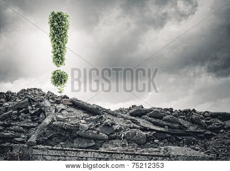 Conceptual image with exclamation mark growing on ruins