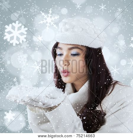 Pretty Girl Blowing Snow On The Hands
