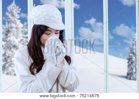 Sneezing Woman With A Tissue
