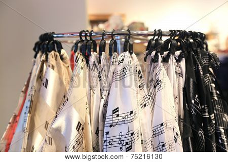 Shawls With Musical Notes Hanging On Hooks