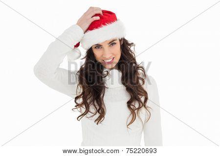 Confused brunette in santa hat on white background