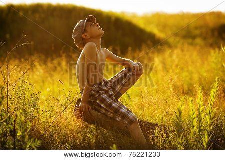Happy Boy Sitting And Dreams