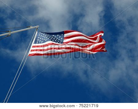 The American Flag Hanging Before Wispy Clouds
