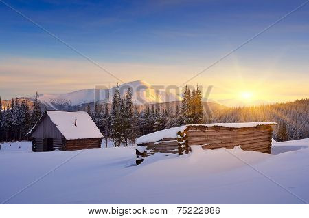 Winter landscape with hut. Sunrise in the mountains. Carpathians, Ukraine, Europe