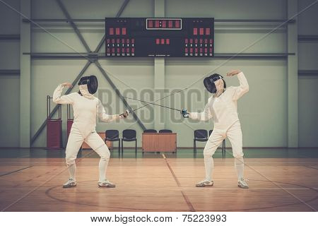 Two women fencers on a training