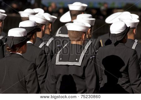NEW YORK - NOV 11, 2013: US Navy sailors from the USS New York march during the 2013 America's Parade held on Veterans Day in New York City on November 11, 2013.