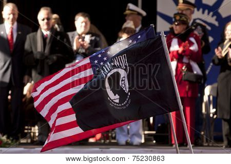NEW YORK - NOV 11, 2013: The American Flag and POW/MIA flag wave as marchers pass the VIP viewing stand during the 2013 America's Parade held on Veterans Day in New York City on November 11, 2013.