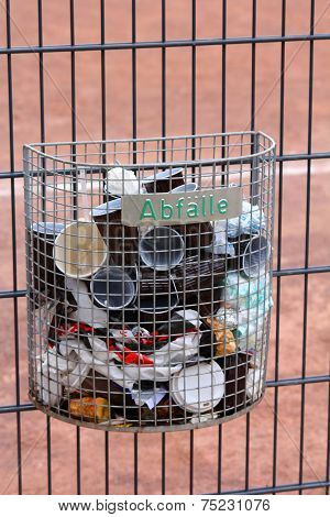 The Trash Bin On Metal Fence