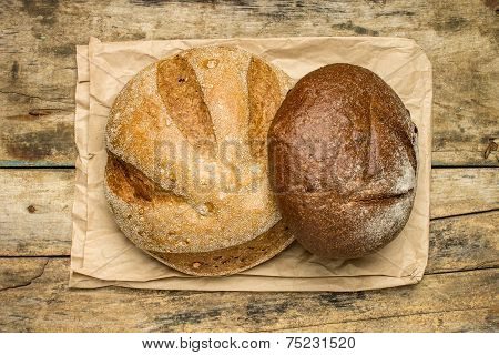 Loafs Of Different Species Of Bread On Wood Background