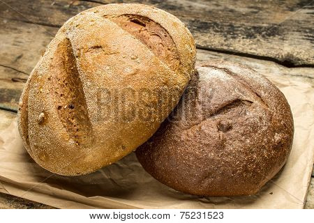 Two Species Of Bread On Paper Bag
