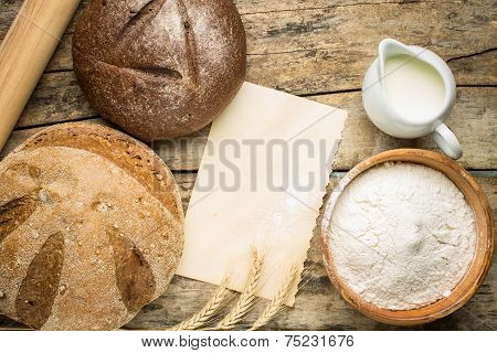 Bakery Ingredients With Fresh Loaf Of Bread.