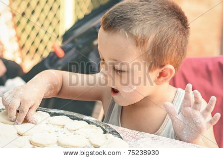 Little Boy Making Dumplings